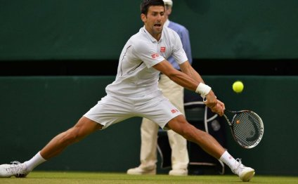 Novak Djokovic hits a winner