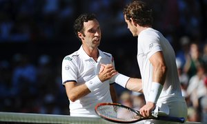 Andy Murray shakes fingers with Mikhall Kukushkin, after winning in right units.
