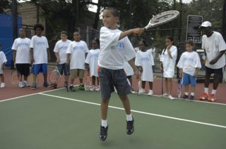 kids training during the playing tennis camp in Crotona Park.