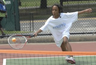 kiddies practice within playing tennis camp in Crotona Park.