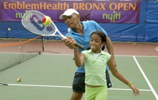 kiddies practice at the playing tennis camp in Crotona Park.