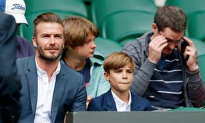David Beckham together with boy Romeo at Centre Court at Wimbledon.