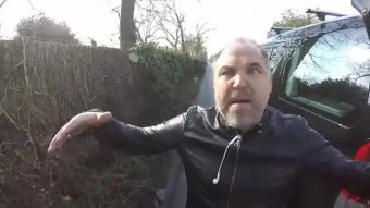 during four-minute video clip, Mr Wells shouts for cyclist to: 'Put your bike down you ****. ******* idiot. I'd ******* consume you for breakfast. You simple ****'