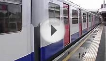 London Underground D Stock 7021 and 7504 departing Wimbledon