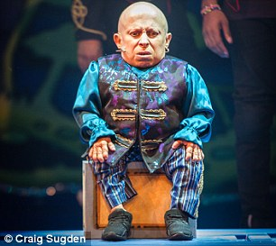 Wimbledon's routine affair stars American Verne Troyer, that is little taller than a magnum of claret